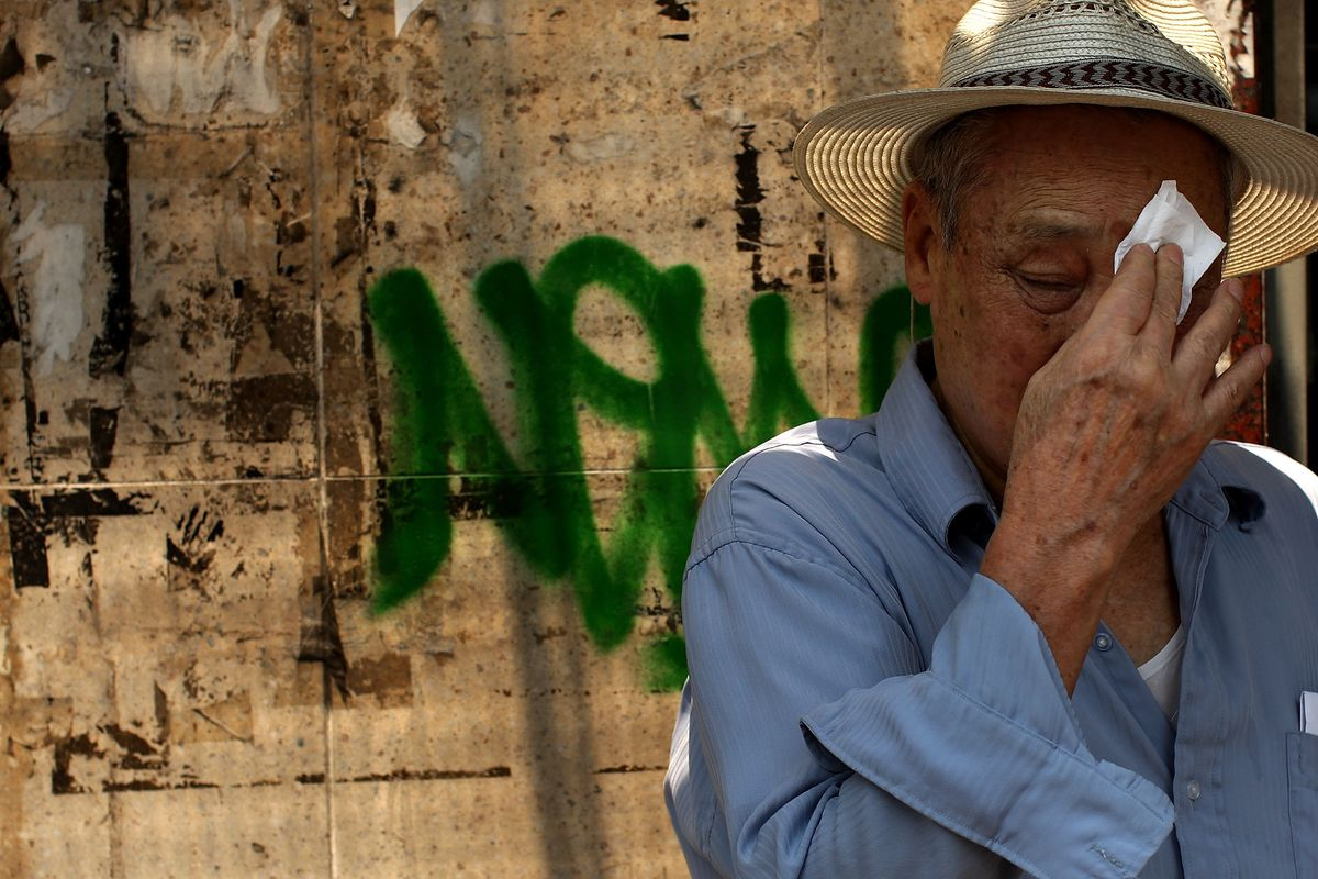 A man wipes sweat from his face July 10, 2007 in New York City. New York City is experiencing a second day of a heat wave with temperatures in the upper 90`s and uncomfortable humidity levels.