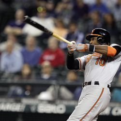 Baltimore Orioles' Adam Jones hits a two-run home run in the 11th inning of a baseball game against the Seattle Mariners, Wednesday, Sept. 19, 2012, in Seattle.