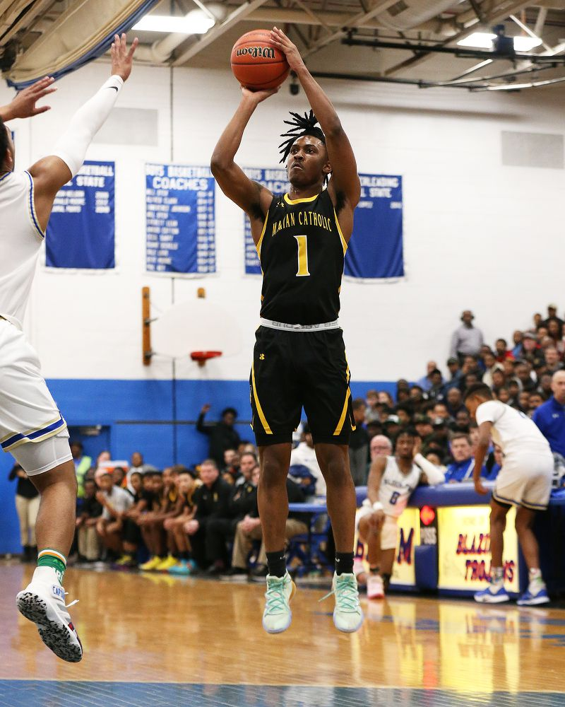 Marian Catholic's Ahron Ulis (1) rises up for a shot against Bloom.
