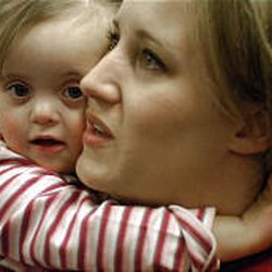 Carrie Ormsby gets a big hug from daughter Lauren, 2, at the West Valley City Family and Fitness Center.