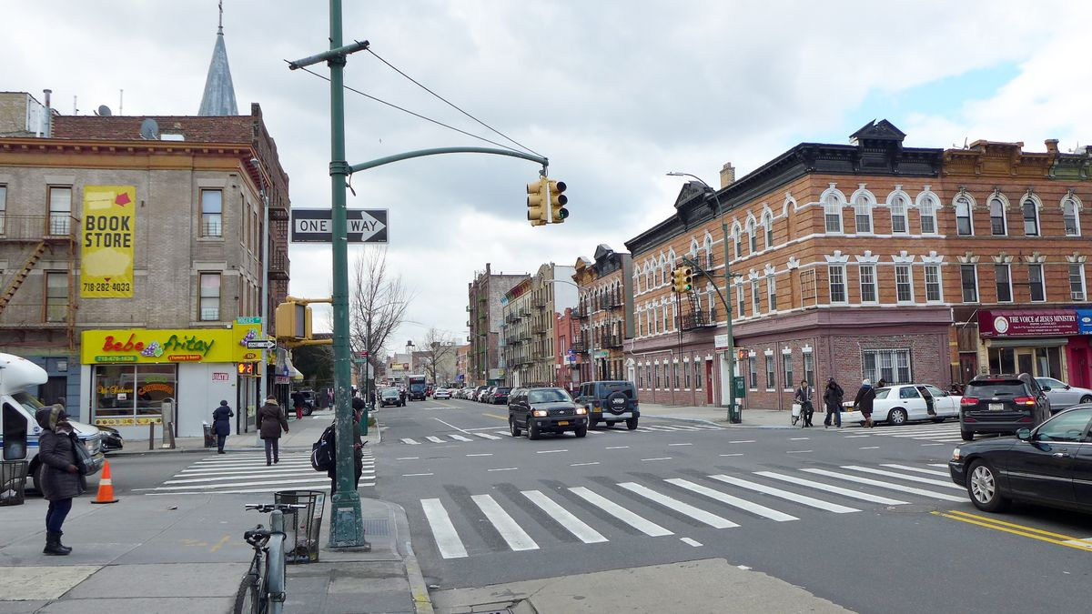 A view of Flatbush looking west on Church Avenue, with Flatbush Dutch Reformed Church poking up in the distance.