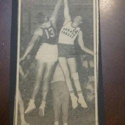 Newspaper clipping shows Bob Skousen tipping with an Australian basketball player.