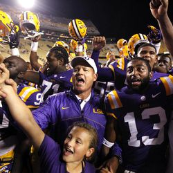 LSU head coach Les Miles center, sings the LSU alma mater with his daughter Macy Miles, below, and his team, after their NCAA college football game against Idaho in Baton Rouge, La. Saturday, Sept. 15, 2012. LSU won 63-14.