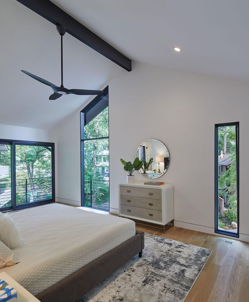 Bedroom with multiple asymmetrical windows.