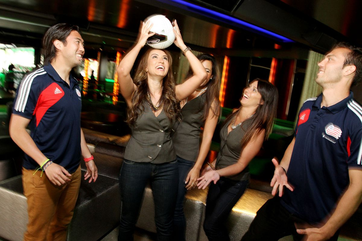 A.J. Soares and Lee Nguyen take the staff through some drills at the Emerald Lounge in Boston's Revere Hotel Boston Common.
