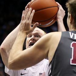 Brigham Young Cougars guard TJ Haws (30) shoots past Santa Clara Broncos forward Josip Vrankic (13) at Brigham Young University in Provo on Thursday, Feb. 20, 2020.