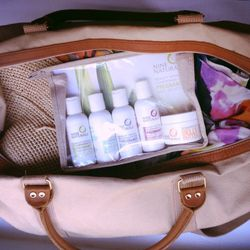 """Last minute packing for Mexico where my family and I will be meeting with three of my best friends and their families. Threw in my <b><a href=""""http://www.ninenaturals.com/products/gift-sets/nine-naturals-pregnancy-travel-gift-set.html"""">Nine Naturals</a></"""