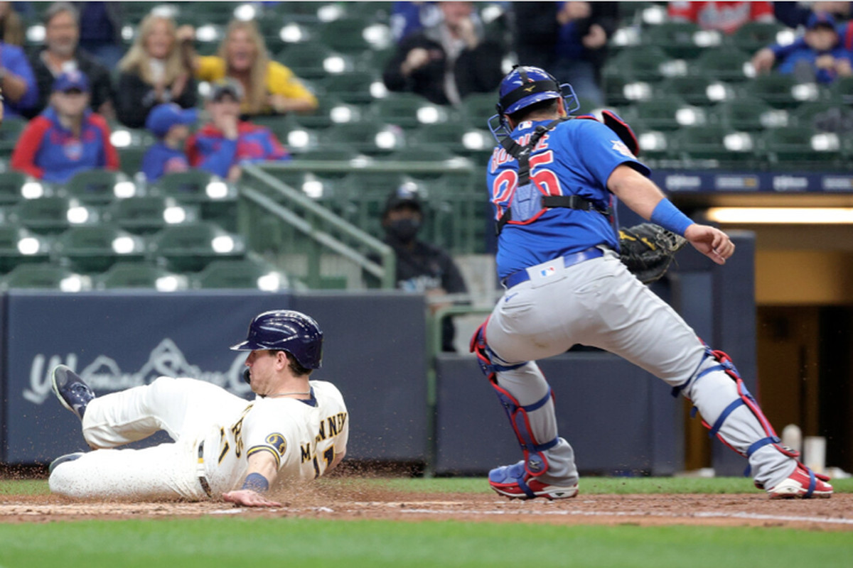 The Brewers' Billy McKinney scores past Cubs catcher Austin Romine during the sixth inning Tuesday in Milwaukee.