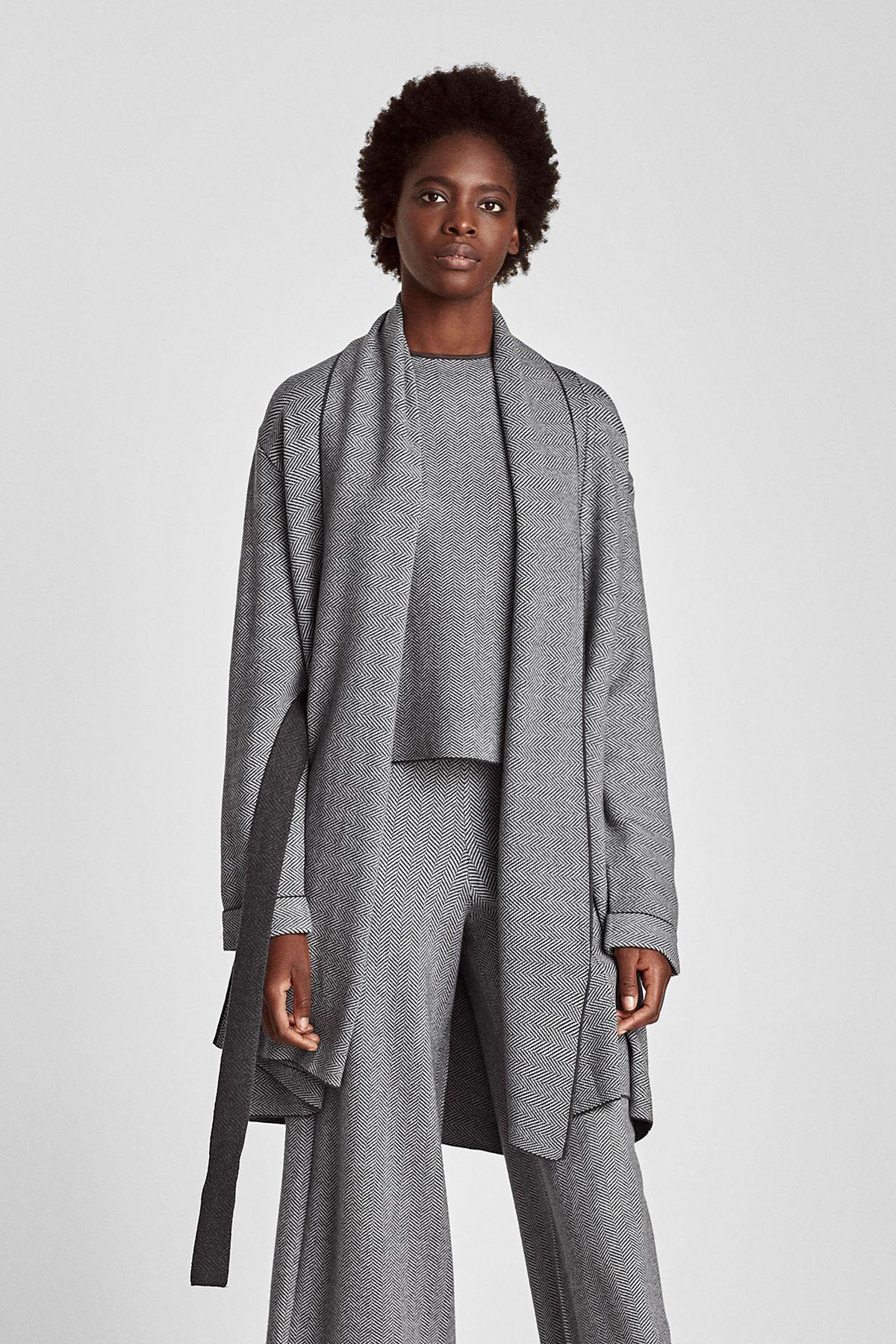 a grey wrap sweater