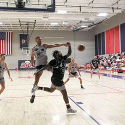 Teams compete in a Powder League basketball game at American Preparatory Academy in Draper on Friday, June 25, 2021.