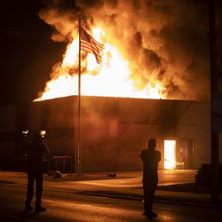 The Wisconsin Department of Corrections' Community Corrections Division at 1212 60th St. in Kenosha was one of several businesses to burn during the second night of unrest after police shot Jacob Blake, Monday night, Aug. 24, 2020.