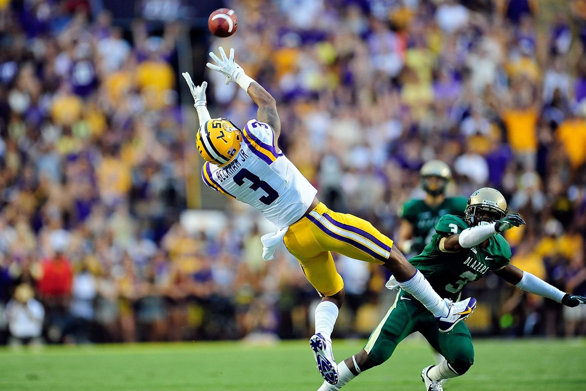 Odell Beckham Jr. #3 of the LSU Tigers catches a pass in front of Lamarcus Farmer #3 of the UAB Blazers during a game at Tiger Stadium on September 7, 2013 in Baton Rouge, Louisiana.