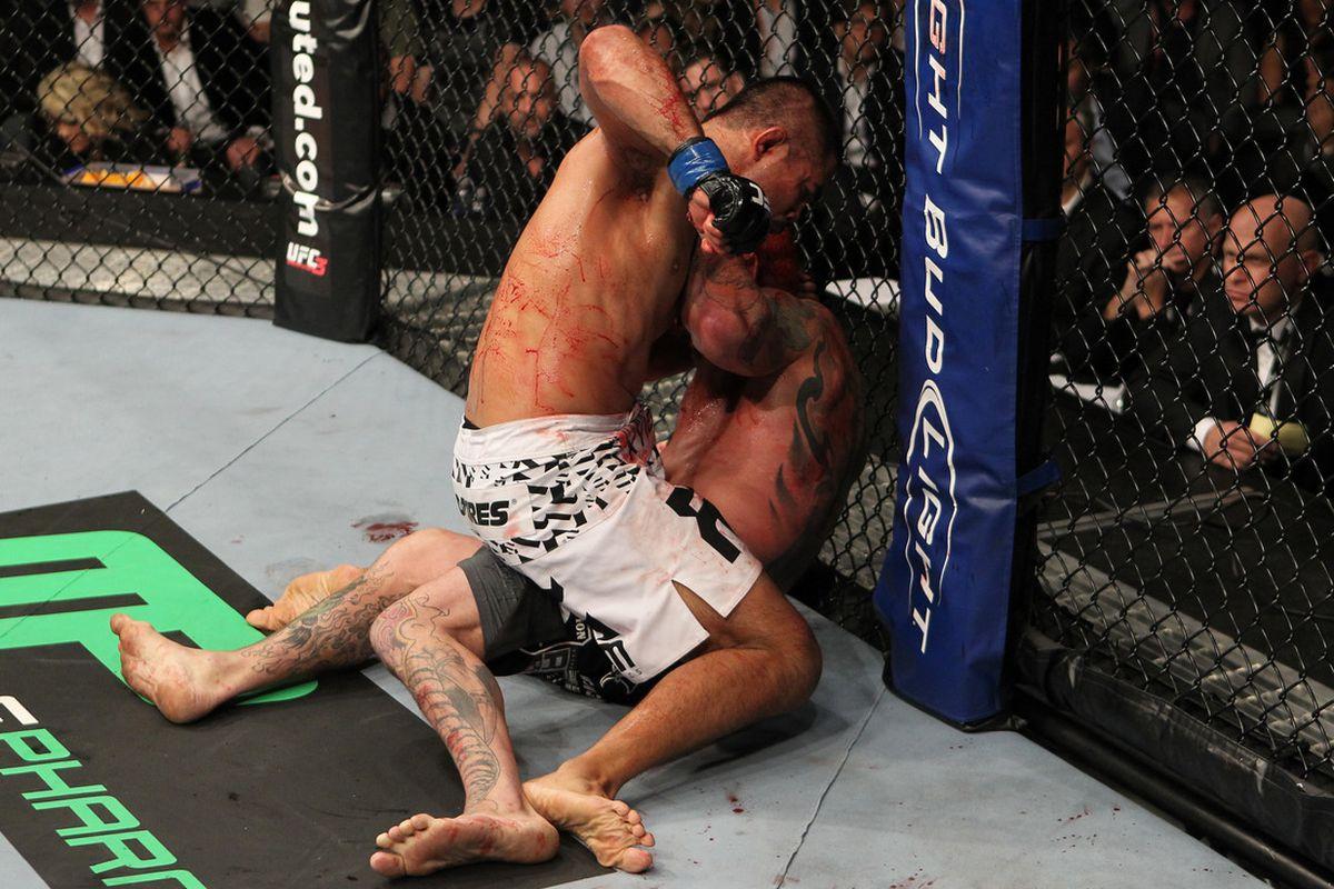 BIRMINGHAM, ENGLAND - NOVEMBER 05: (L-R) Mark Munoz punches Chris Leben during the UFC 138 event at the LG Arena on November 5, 2011 in Birmingham, England. (Photo by Josh Hedges/Zuffa LLC/Zuffa LLC via Getty Images)