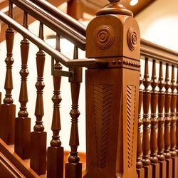 A wooden staircase adds elegance to the Victorian interior design of the Provo City Center Temple.