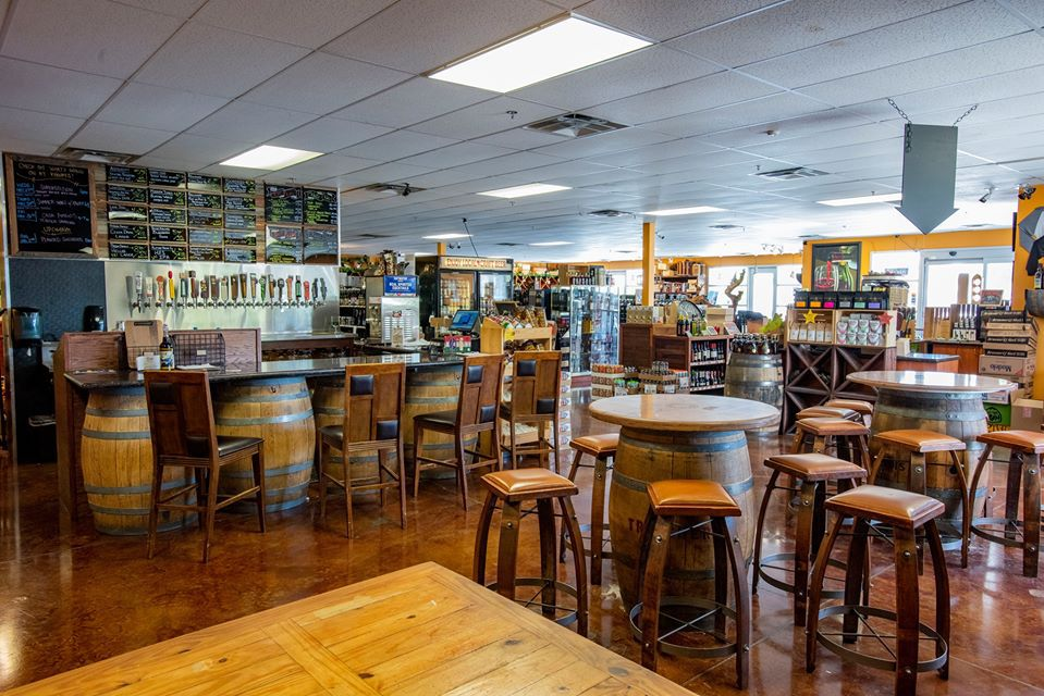Store interior with seating area and bar outfitted with beer taps