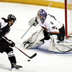 Andrew Engelage of Utah, right, deflects the shot by Las Vegas as the Utah Grizzlies face the Las Vegas Wranglers in ECHL hockey at the Maverik Center in West Valley City, Monday, April 2, 2012.