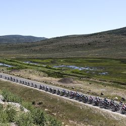 The peloton heads along East Richardson Flat Road during Stage 6 of the Tour of Utah outside of Park City on Sunday, Aug. 18, 2019.