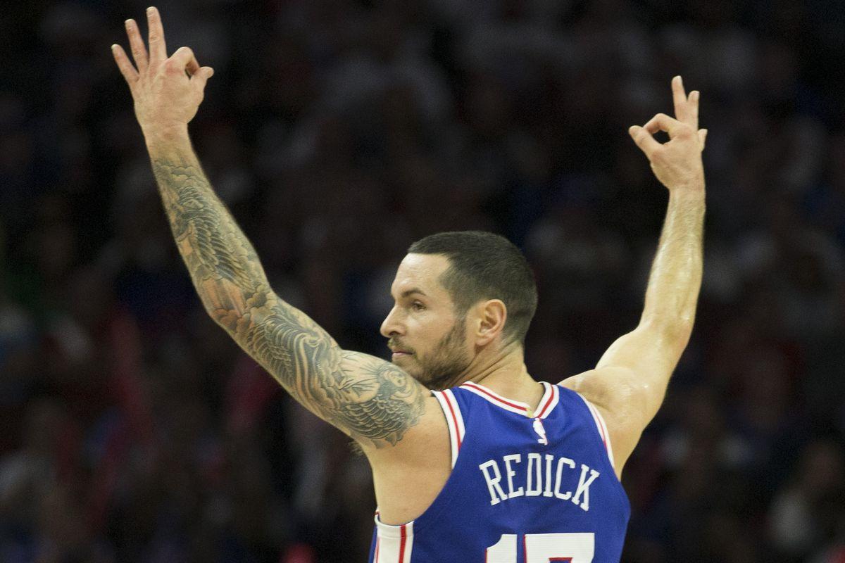 J.J. Redick raising his arms