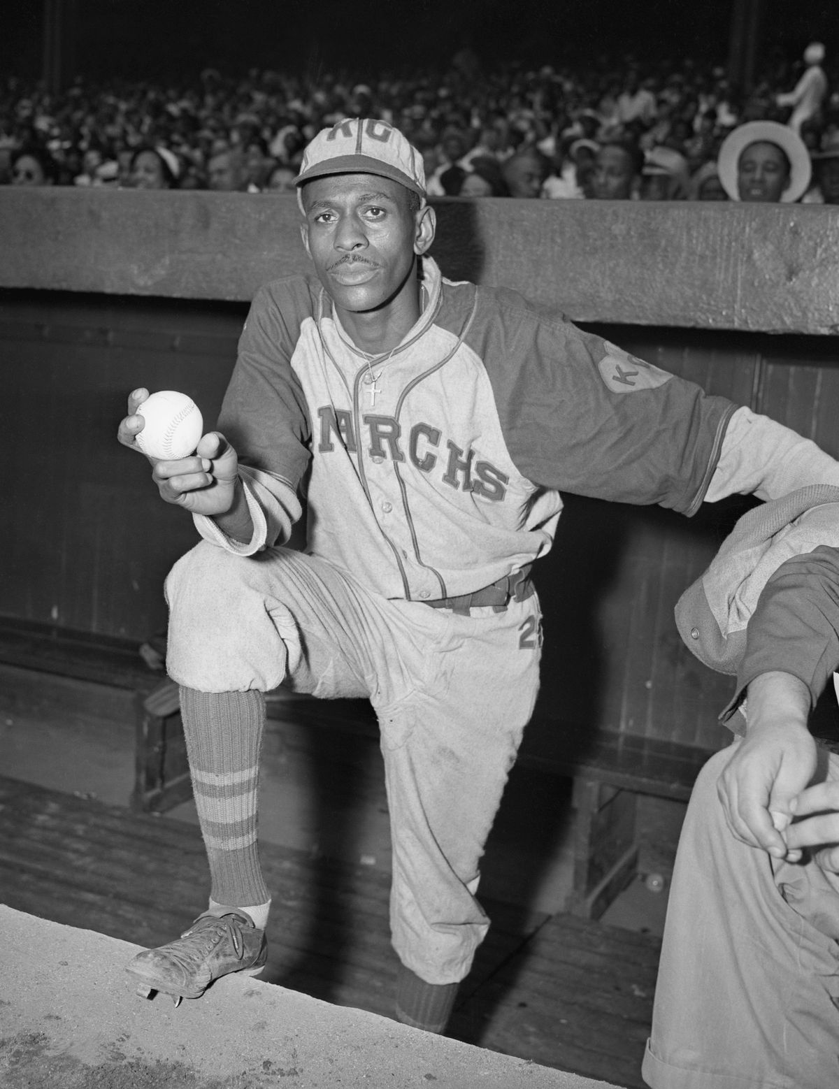 Pitcher Satchel Paige Standing in Dugout