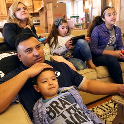 Clockwise from bottom, KK, Kalani, Timberly, Sadie and Skye Sitake play Wii at home in Provo on Friday, March 11, 2016.