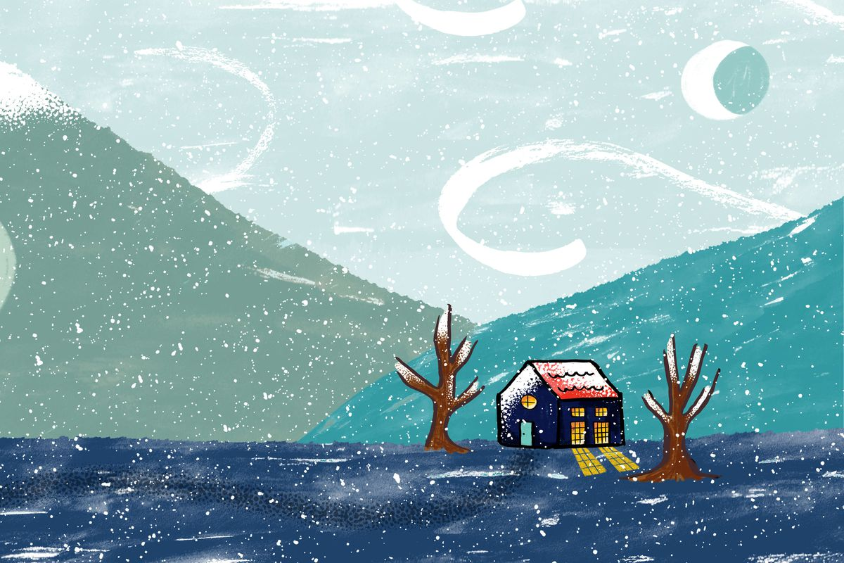 A small, cozy house in a wintery landscape
