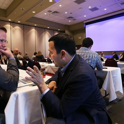 Matt Castleberry, left, and Ryan Layton talk during a break between courses at the MountainWest Capital Network Business Boot Camp in Sandy on Wednesday, March 23, 2016.