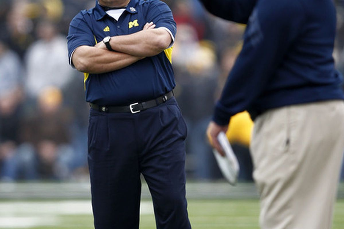 Brady Hoke and Greg Mattison know that offering players who need a great deal of development can be risky. Good thing they can coach. (Photo by Joe Robbins/Getty Images)