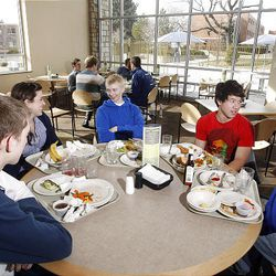 Dalton Griner of Sandy, Utah (center) sits in the BYU Cannon Center and talks with friends after eating lunch.