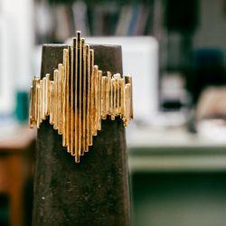 "Vibrations Cuff, <a href=""http://www.psyche-jewelry.com/product/vibrations-cuff"">$240</a>"