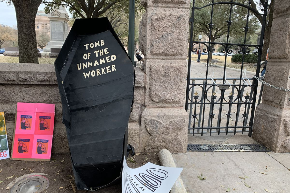 The service worker rally featured a fake coffin dedicated to an unnamed worker