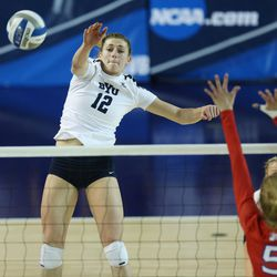 BYU's Roni Jones-Perry hits over American's Shannon Webb during the NCAA tournament in Provo on Friday, Dec. 1, 2017.