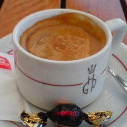 "<b>Cortado</b>: Espresso and three ounces of steamed milk (between a macchiato and a cappuccino) (<a href=""http://www.fanpop.com/spots/coffee/images/425571/title/cafe-cortado-photo"" rel=""nofollow"">Photo</a>)"