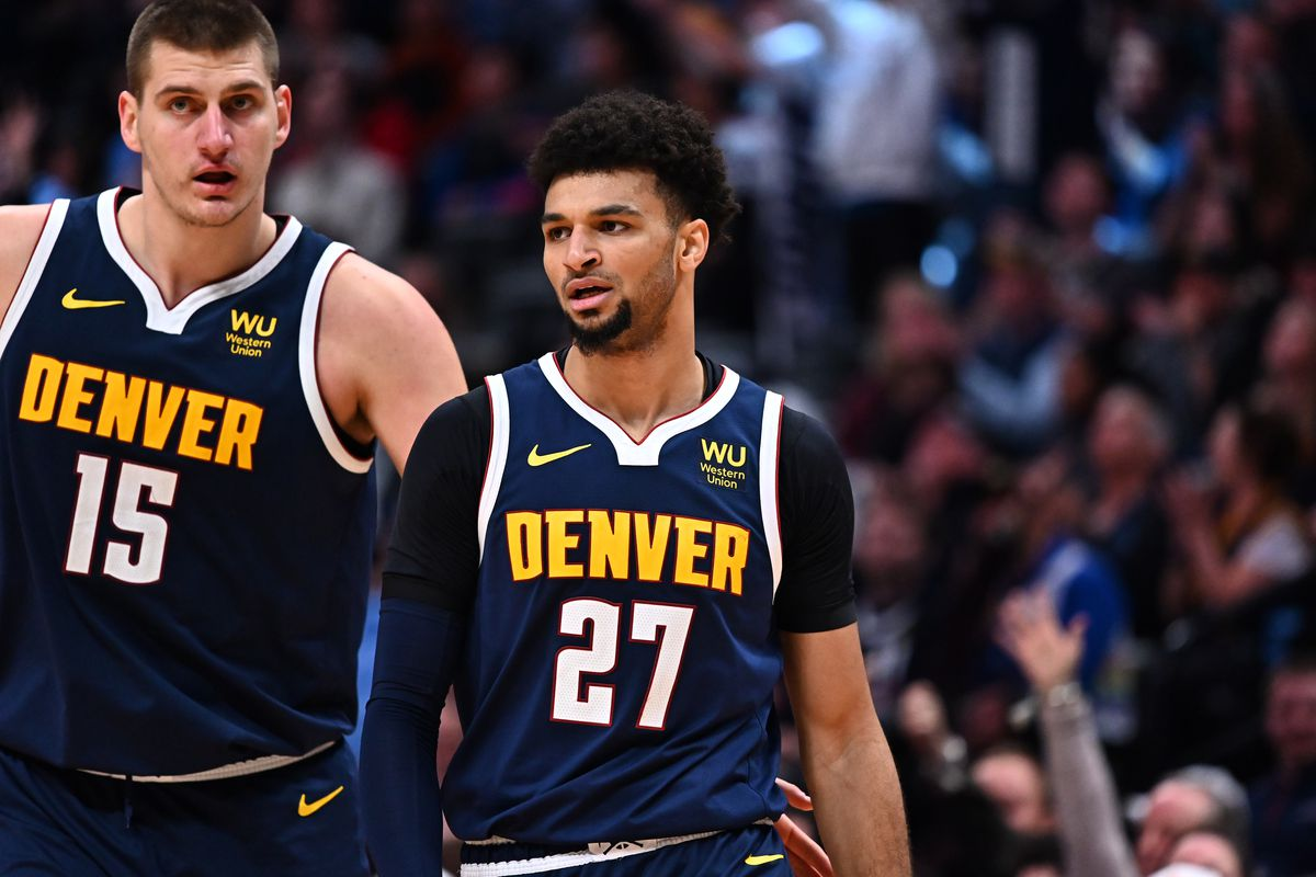 Denver Nuggets guard Jamal Murray and center Nikola Jokic react during the second half against the Orlando Magic at the Pepsi Center.
