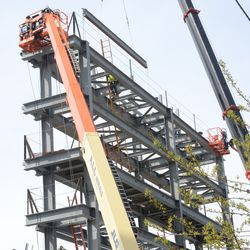 2:58 p.m. A closer view of the girder being lifted to the top of the video board structure -