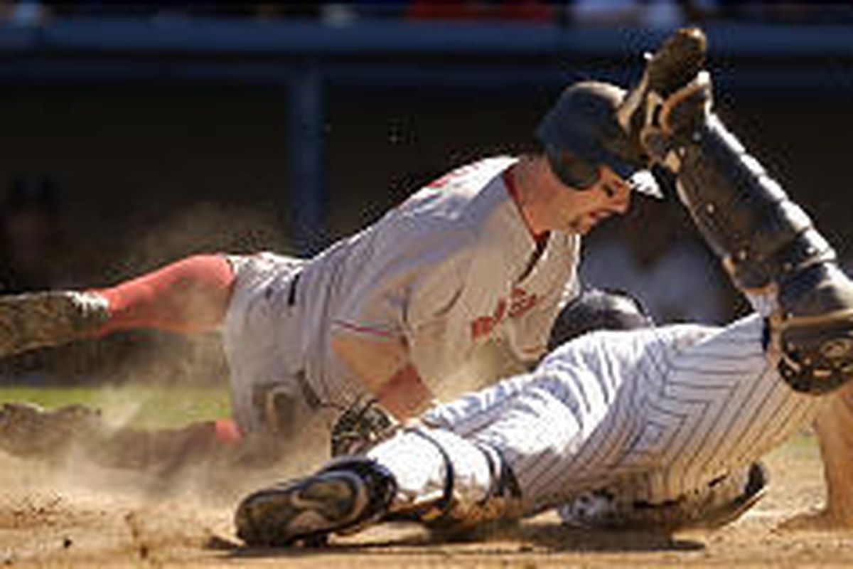 Red Sox' Trot Nixon slides past Yankees' catcher Jorge Posada in eighth inning of Boston's victory.