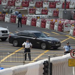 A convoy believed to be carrying the Chinese President's past through security barricades in Hong Kong, Thursday, June 29, 2017. Hong Kong is planning a big party as it marks 20 years under Chinese rule. Fireworks, a gala variety show and Chinese military displays are among the official events planned to coincide with a visit by Xi starting Thursday for the occasion.