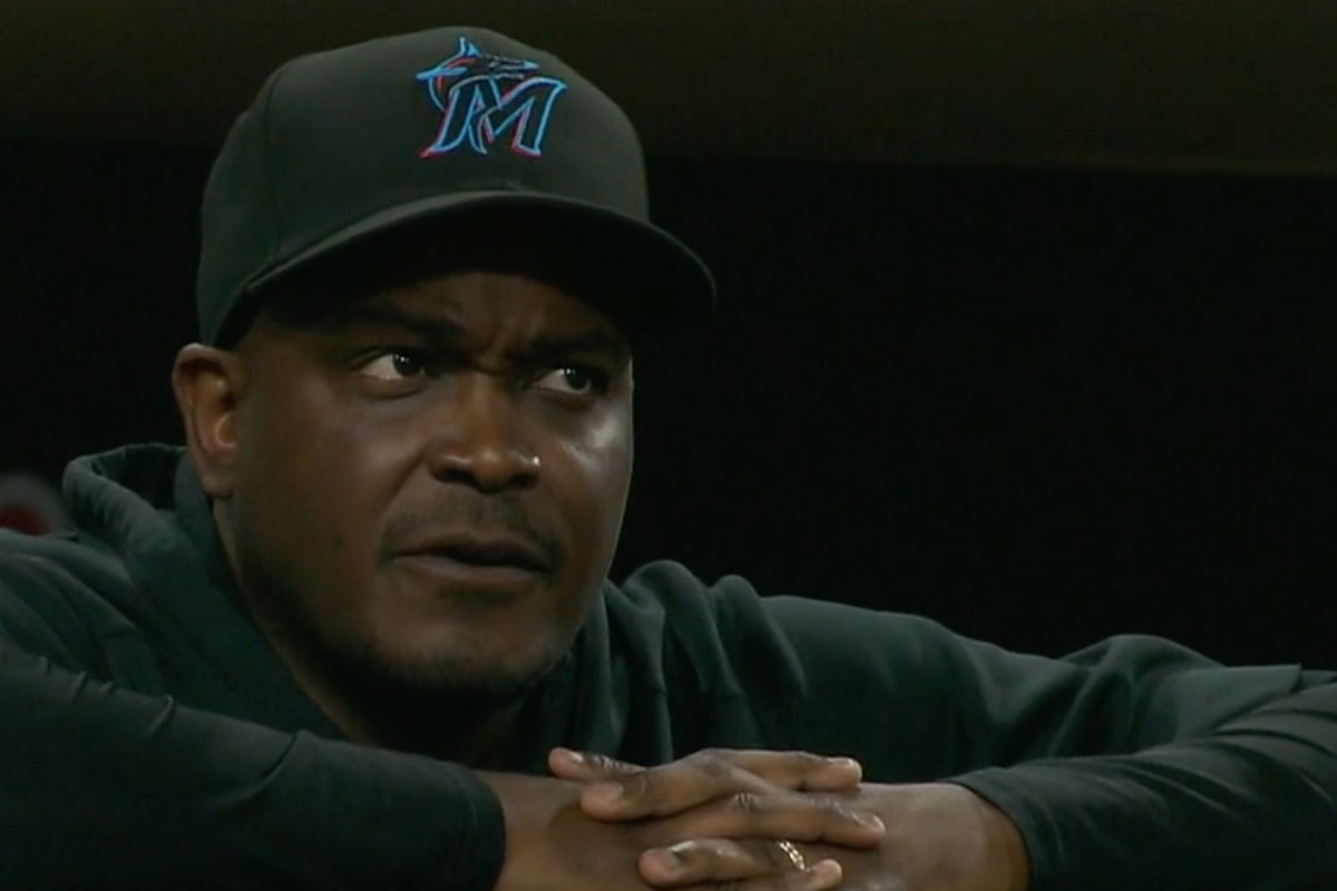 Marlins acting manager James Rowson looks on from the dugout