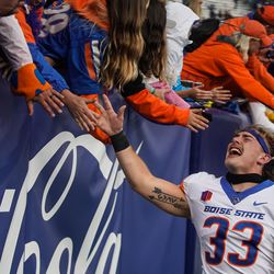Boise State running back Tyler Crowe celebrates the win against BYU with fans at LaVell Edwards Stadium in Provo on Saturday, Oct. 9, 2021.