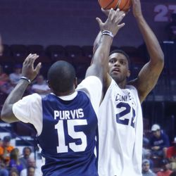 Rudy Gay shoots over the arm of Rodney Purvis.