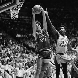 Utah's Danny Vranes, 23, gets the rebound from North Carolina's Al Wood, 30, in their NCAA game in Salt Lake City, Utah, on Thursday, March 20, 1981.