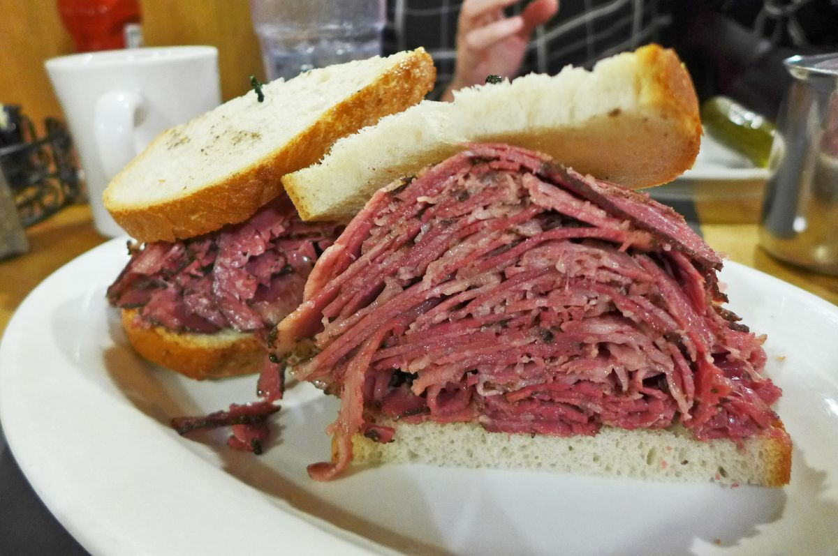 Just about the thickest pastrami sandwich ever seen.