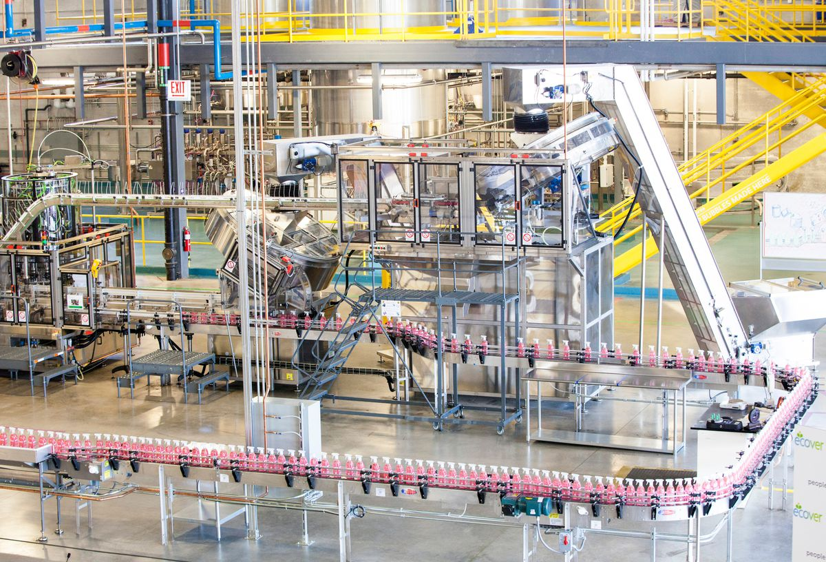 Bottles of household cleaner move along the line at Method's manufacturing plant in Pullman.