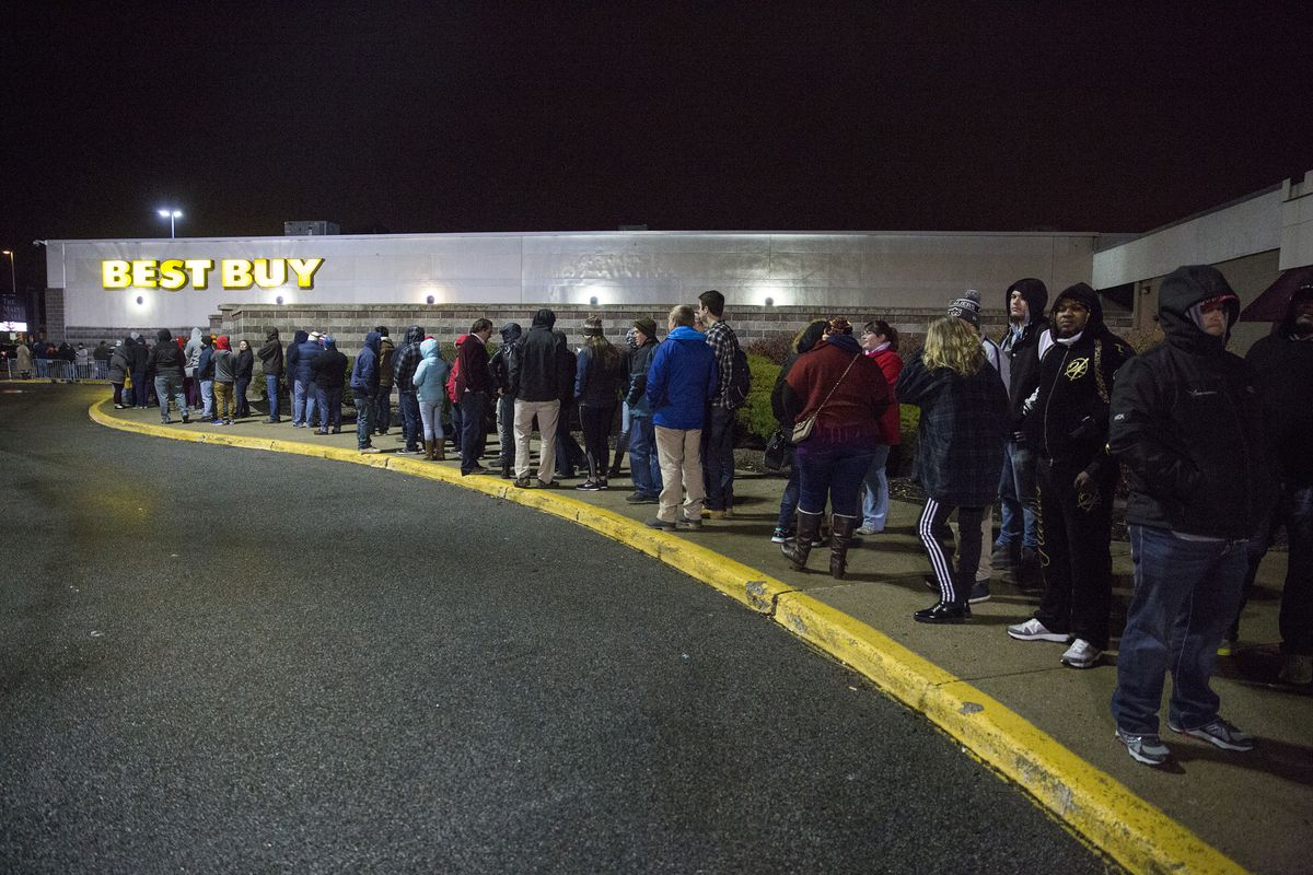 People lined up outside a Best Buy store overnight waiting for it to open