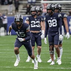BYU players warm up before competing against Boise State during an NCAA college football game at LaVell Edwards Stadium in Provo on Saturday, Oct. 9, 2021.