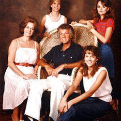 Hot Rod Hundley poses for family portrait.