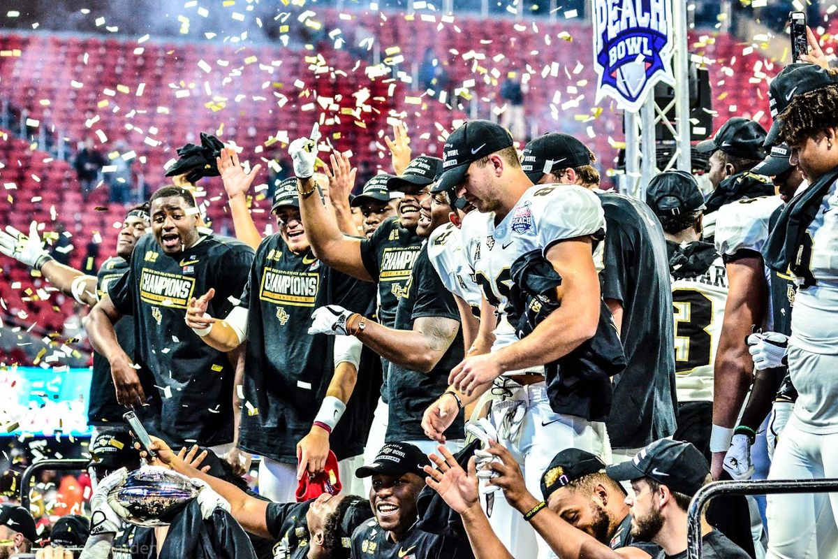 The UCF Knights celebrate their Peach Bowl victory -- and national championship -- in Atlanta on Jan. 1. (Photo: Derek Warden)