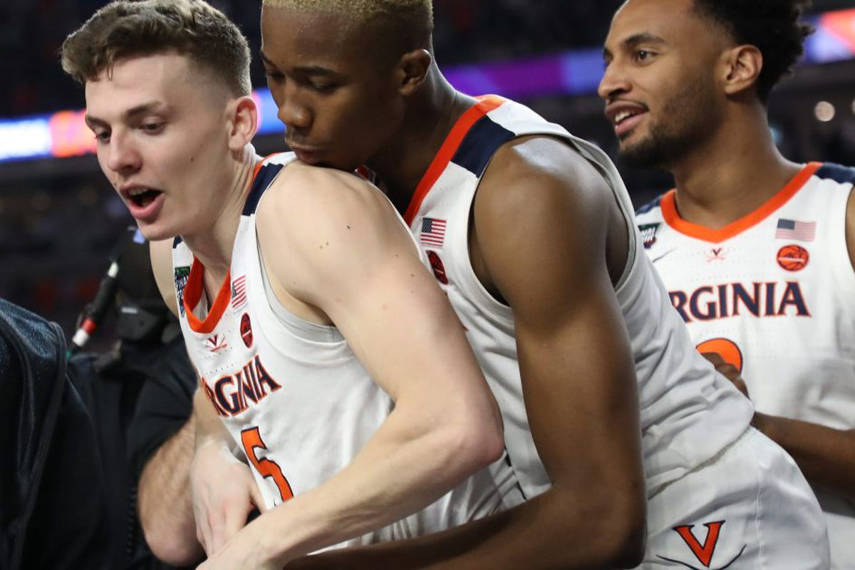 aaa64b8ff18 ... Guy  5 of the Virginia Cavaliers celebrates with Mamadi Diakite  25  after defeating the Auburn Tigers 63-62 during the 2019 NCAA Final Four  semifinal at ...