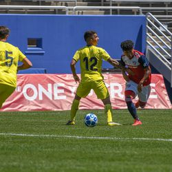 Kevin Bonilla (12) nutmeg during the opening match of the 40th Annual Dallas Cup.