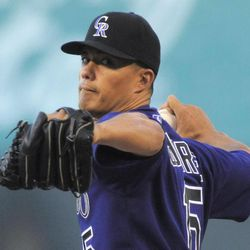 Colorado Rockies starting pitcher Jeremy Guthrie throws against the San Diego Padres during the first inning of a baseball game Monday, April 16, 2012, in Denver.