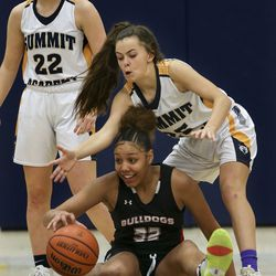 Judge Memorial's Teya Sidberry (32) dribbles from the floor as Summit Academy's Ella Christian (25) tries to steal the ball at Summit Academy in Bluffdale on Thursday, Jan. 9, 2020.